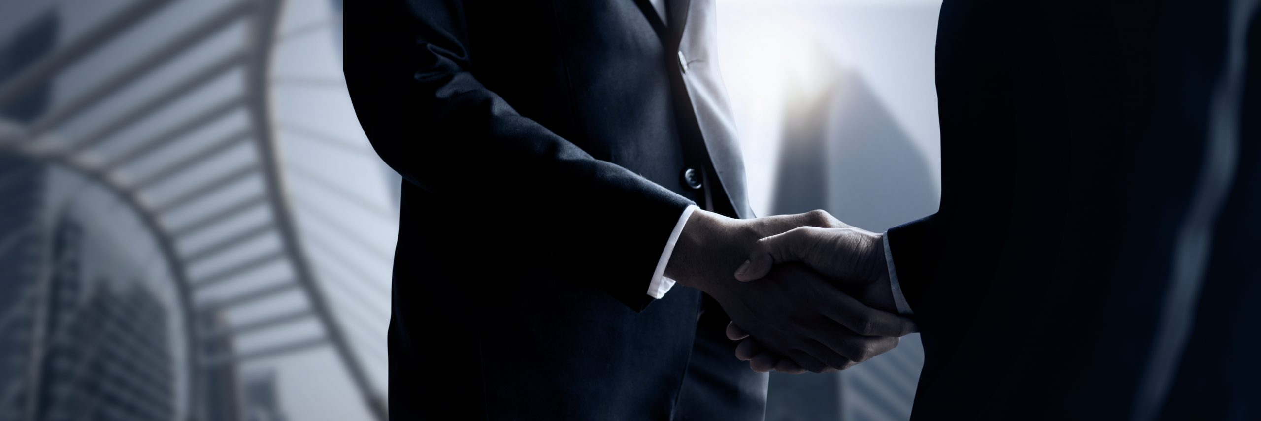 Business people shaking hands, close up hand shake of successful